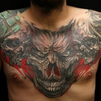 Enormous colored chest tattoo of monster skull combined with with human skulls