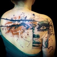 Enormous multicolored upper back and shoulder tattooo of strange ornaments with woman face