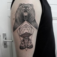 Evil black bear and geometric tattoo for men on upper arm