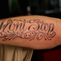 Fine curle-lettered wont stop quote tattoo on arm