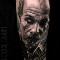 Floki portrait tattoo on arm by Michael Taguet
