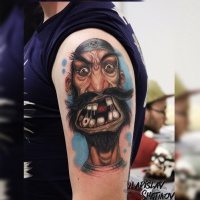 Funny cartoon pirate tattoo on shoulder
