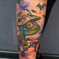 Funny chameleon tattoo on leg