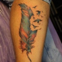 Funny colored-ink feather bird tattoo on leg