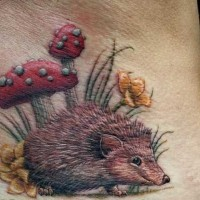 Funny colorful hedgehog in garden tattoo on lower back