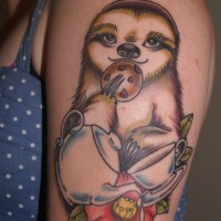 Funny designed cartoon like colored animal sloth with tea and cookies tattoo on shoulder