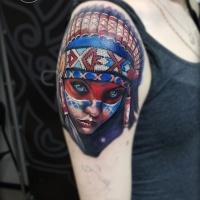 Girl in war bonnet on shoulder