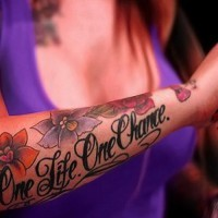 Girly one life one chance quote with colorful flowers tattoo on arm