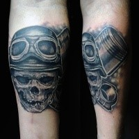 Gray washed detailed foreamr tattoo fo pilot skull with crossed pistons