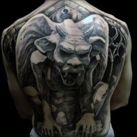 Gray washed style large whole back tattoo of stone gargoyle statue
