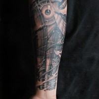 Great biomechanical muscles and eye tattoo on arm