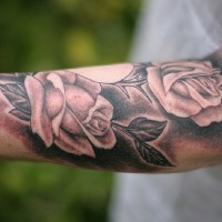 Great black-and-white rose flowers tattoo for men on arm