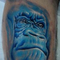 Great blue-ink chimpanzee muzzle tattoo on arm