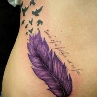 Great fluffy violet feather bird with quote tattoo on side