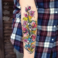 Great girly flower tattoo on wrist