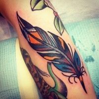Great old school colorful feather tattoo for men on arm