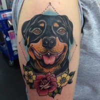 Great old school colorful rottweiler with flowers tattoo on upper arm