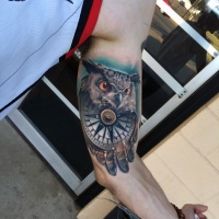 Great owl and compas tattoo on arm