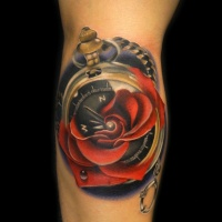 Great red rose and compas tattoo on arm