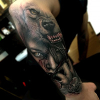 Great tattoo with waoman face and wolf