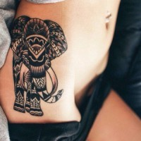 Great tribal black-ink mammoth tattoo on side