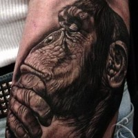 Great uncolored thinking chimpanzee tattoo on arm