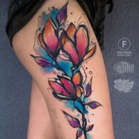 Great watercolor flower tattoo on hip