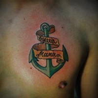 Green anchor with ribbon lettering tattoo for men on chest