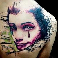 Homemade style colored tattoo of crying woman with star