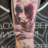 Horror binded bloody head tattoo on shoulder