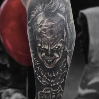 Horror clown tattoo on forearm
