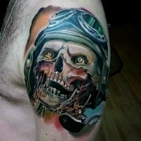 Horror like colored upper arm tattoo of zombie with pilot helmet