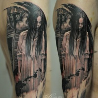 Horror movie girl tattoo on arm