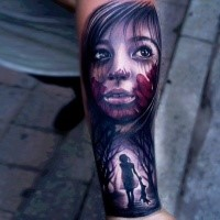 Horror movie themed colored tattoo of bloody girl face