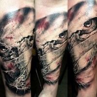 Horror style colored arm tattoo of creepy face under bandage