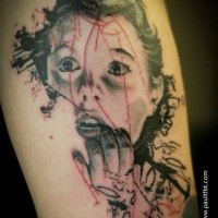 Horror style creepy looking scared woman tattoo