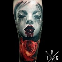 Horror themed colored forearm tattoo of woman portrait with bloody leaps