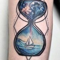 Hourglass space and sea forearm tattoo