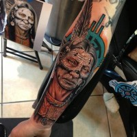 Indian head with war paint tattoo on forearm