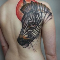 Interesting-designed color-ink zebra head and red sun tattoo on upper back