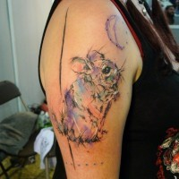 Interesting-designed cute rodent and moon tattooon upper arm