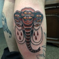Interesting scary old school many-eyed mammoth tattoo on shin