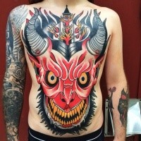 Large old school style chest and belly tattoo of devils head with burning church
