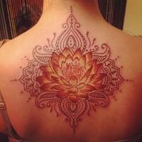 Large red-and-orange tribal lotus flower tattoo on back