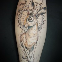 Large unusual colorful hare with deer hornes tattoo on shin