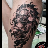 Lion in War bonnet tattoo on thigh