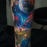 Little boy and space tattoo on forearm