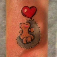 Little girly hedgehog with red-heart balloon tattoo on arm