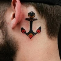 Lonely colored old-school anchor tatoo behind ear