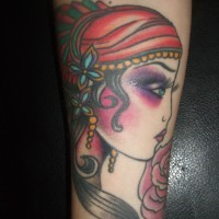 Lovely gypsy girl head tattoo for guys on forearm